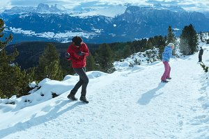 Family in winter Dolomite mountain