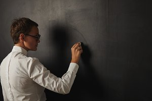 Teacher in white blouse at the blackboard