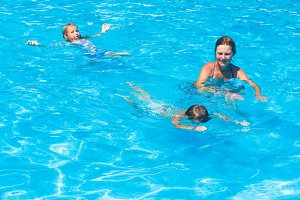Family in swimming pool.