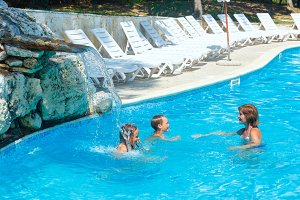 Family in swimming pool.