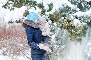 Happy mother and daughter in winter