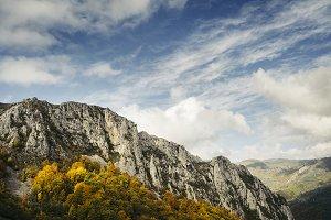 Mountain cliffs under dramatic sky