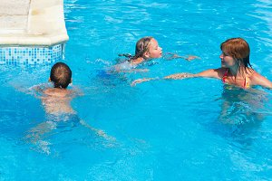 Family in outdoor swimming pool