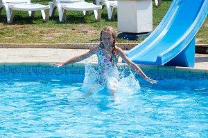Children in outdoor swimming pool