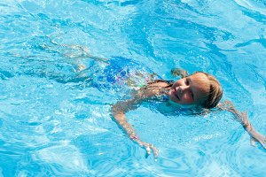 Children in outdoor swimming pool
