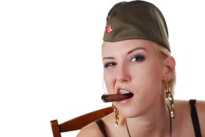 woman in field cap with cigar