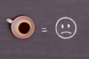 cup of coffee and sad smiley