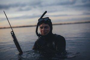 Happy underwater hunter