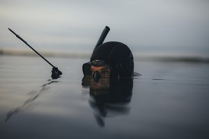 Spearfishing diver looking
