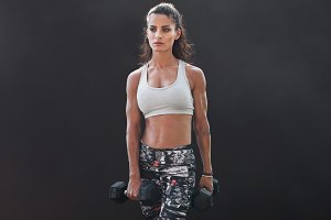 Fitness female doing bodybuilding