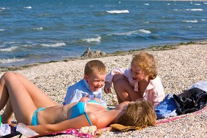 Family near summer sea