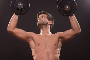 young man worship weights dumbbells