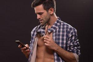 man posing smartphone abs shirt