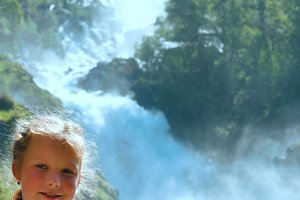 Children near Norway waterfall