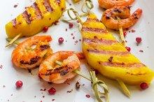 Skewers of mango and shrimp