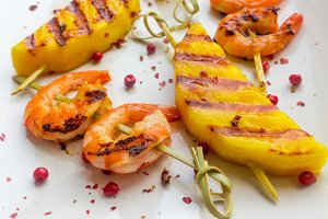 Skewers of mango and shrimp