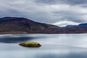 Lake with small island in Iceland