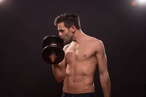 man kissing loving weights dumbbell