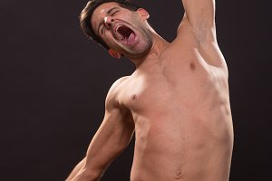 yawning shirtless nude man