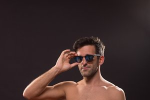confident man abs fit sunglasses