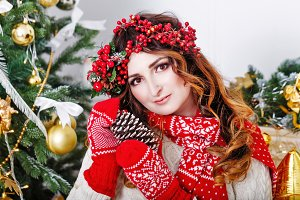 Girl holding pine cone. Christmas