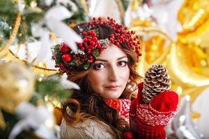 Cute girl holding pine cone. Xmas