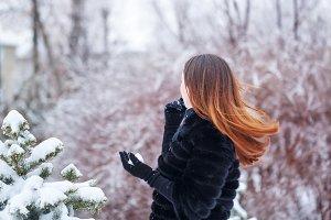A sweet girl in a fur coat