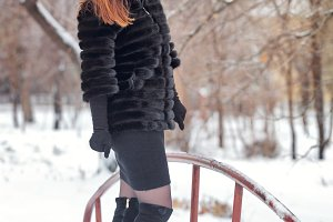 Portrait of a cute girl in fur coat.