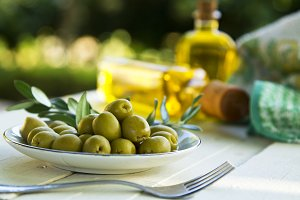 bowl of olives with green branches