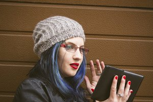 hipster woman with tablet
