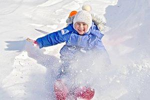 Children sledding down the hills