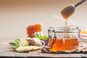 Honey in jar with honey dipper