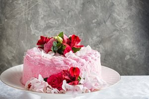 Pink cake with natural flowers