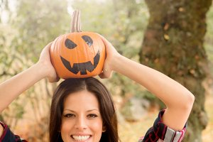 Brunette girl with Halloween pumpkin