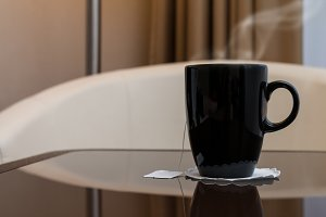 Black cup of hot tea