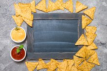 nacho with sauces and chalk board