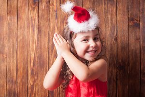 Girl in Santa hat headband