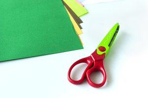 Curty scissors and colored paper