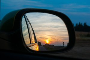 sunset in a car mirror