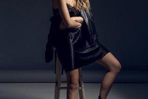 sexy model in black negligee in Studio