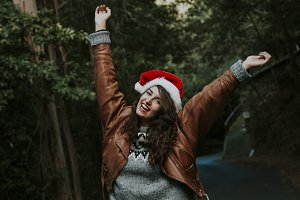 attractive young woman smiling with christmas hat outdoors
