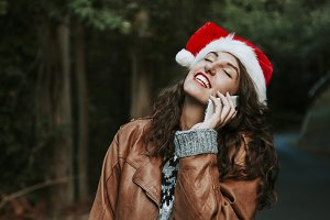 girl with christmas hat talking on mobile phone