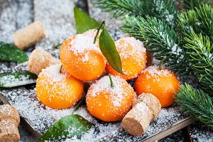 Tangerines with leaves on a snow