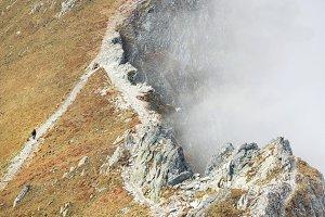 Autumn landscape of foggy mountains
