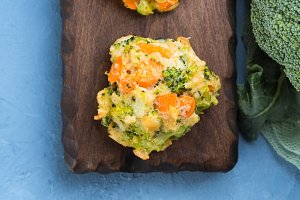 Fritter with carrots and broccoli. Closeup