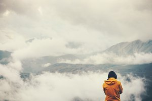 Traveler enjoy cloudy mountains