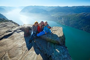 Family on Preikestolen, Norway fjord