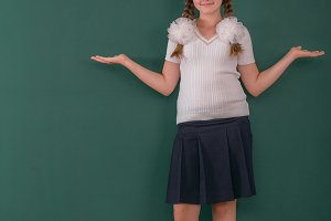 School Girl at a Chalkboard