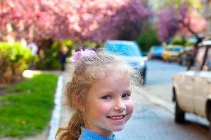 Small girl in spring garden