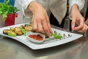 Cook prepares meals in the restaurant presentation.